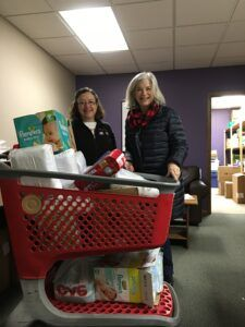 Julie and Brenda delivering the diapers collected by St. Matthew Lutheran Church