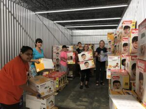 Amazing volunteers sorting diapers.